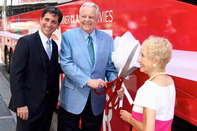 Robert Osborne prepares to cut the ribbon with jane Powell and Dennis Adamovich, SVP, Digital, Affiliate, Lifestyle & Enterprise Commerce, TCM, TBS and TNT.