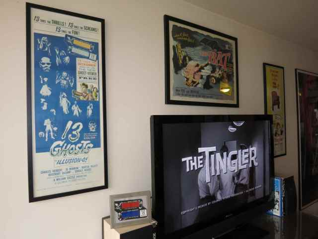 """Inserts for William Castle's 13 GHOSTS (1960) and THE TINGLER (1959) flank my TV, with Crane Wilbur's THE BAT (1959) above. And that's my original 13 GHOSTS """"Ghost Viewer"""" below the poster."""